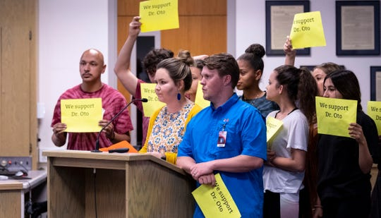 Students surround Mt. Whitney High School teacher Audra Naylor and her husband Jacob Naylor as she speaks to Visalia Unified School District board on Tuesday, May 7, 2019.