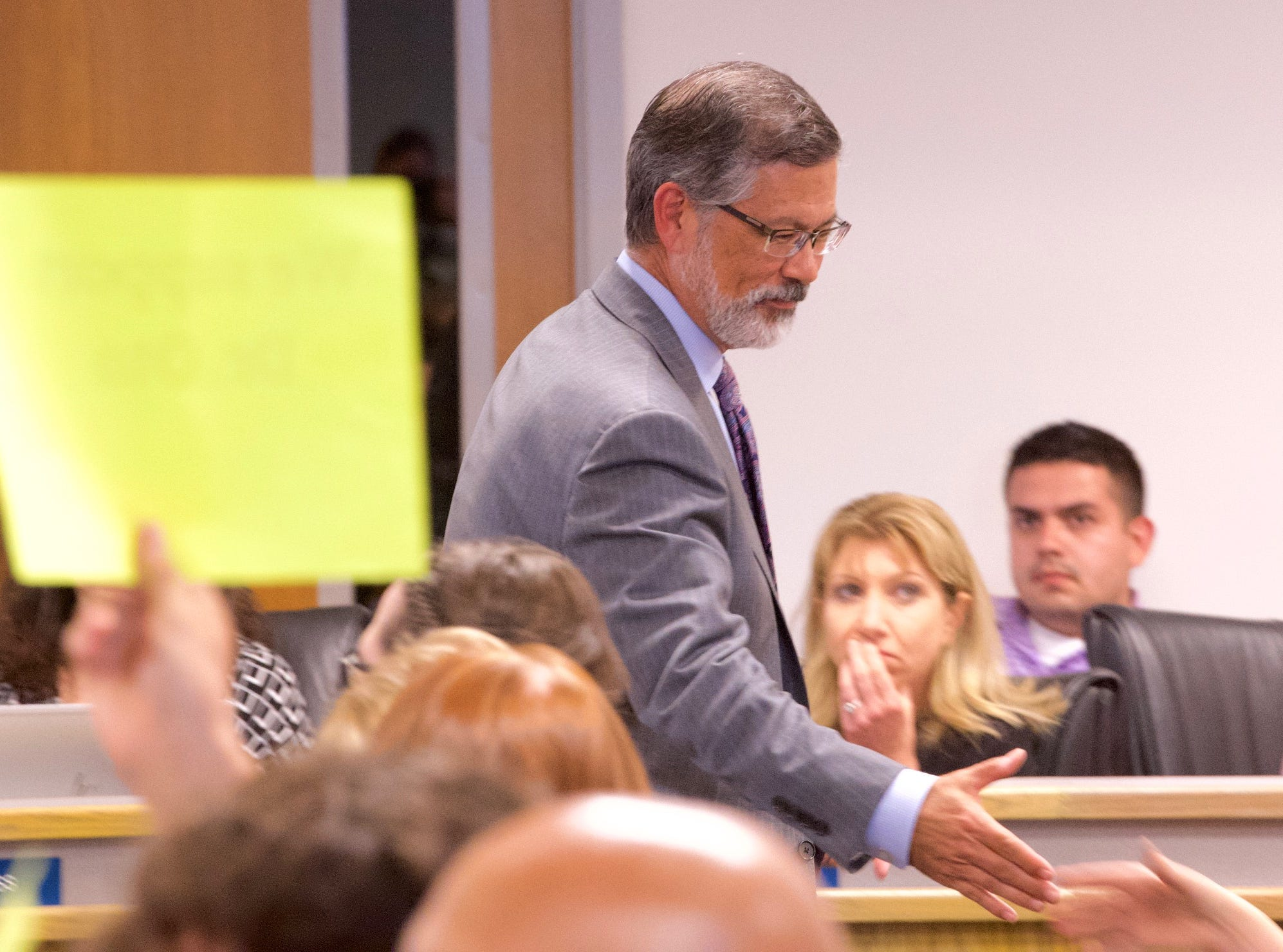 Superintendent Todd Oto shakes the hands of supporters during a special board meeting on Tuesday in Visalia.