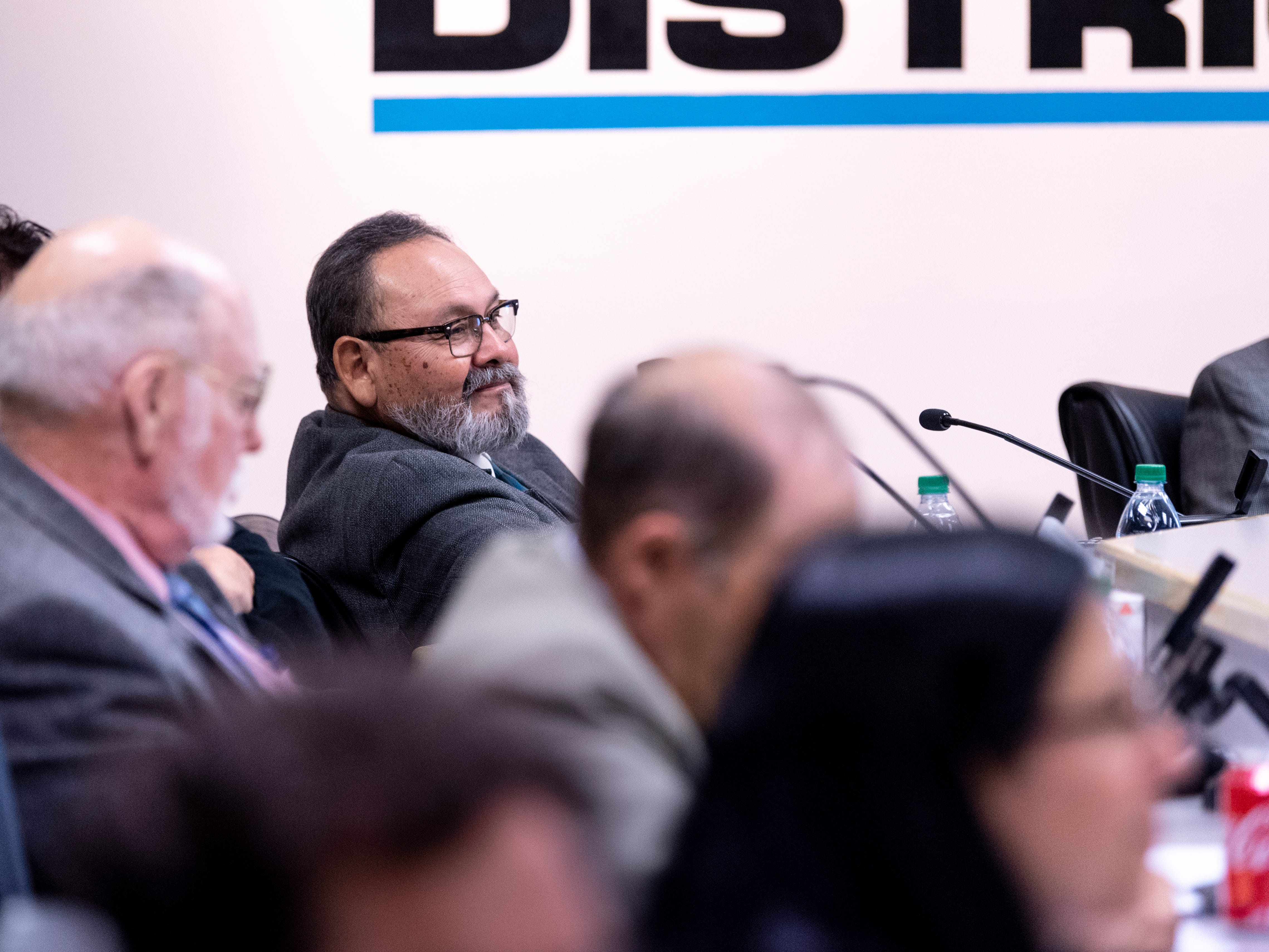 Visalia school board Trustee Juan Guerrero listens as supporters of Todd Oto speak out during the Visalia Unified School District meeting on Tuesday, May 7, 2019.