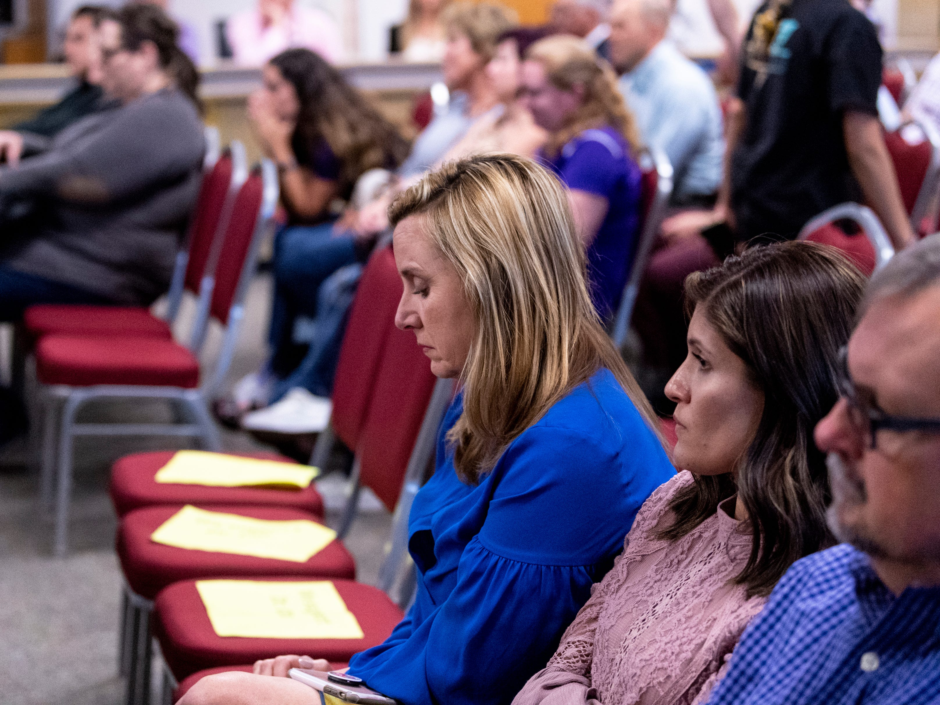 Supporters react to the announcement that the board had voted to accept the resignation of Superintendent Todd Oto on Tuesday, May 7, 2019.