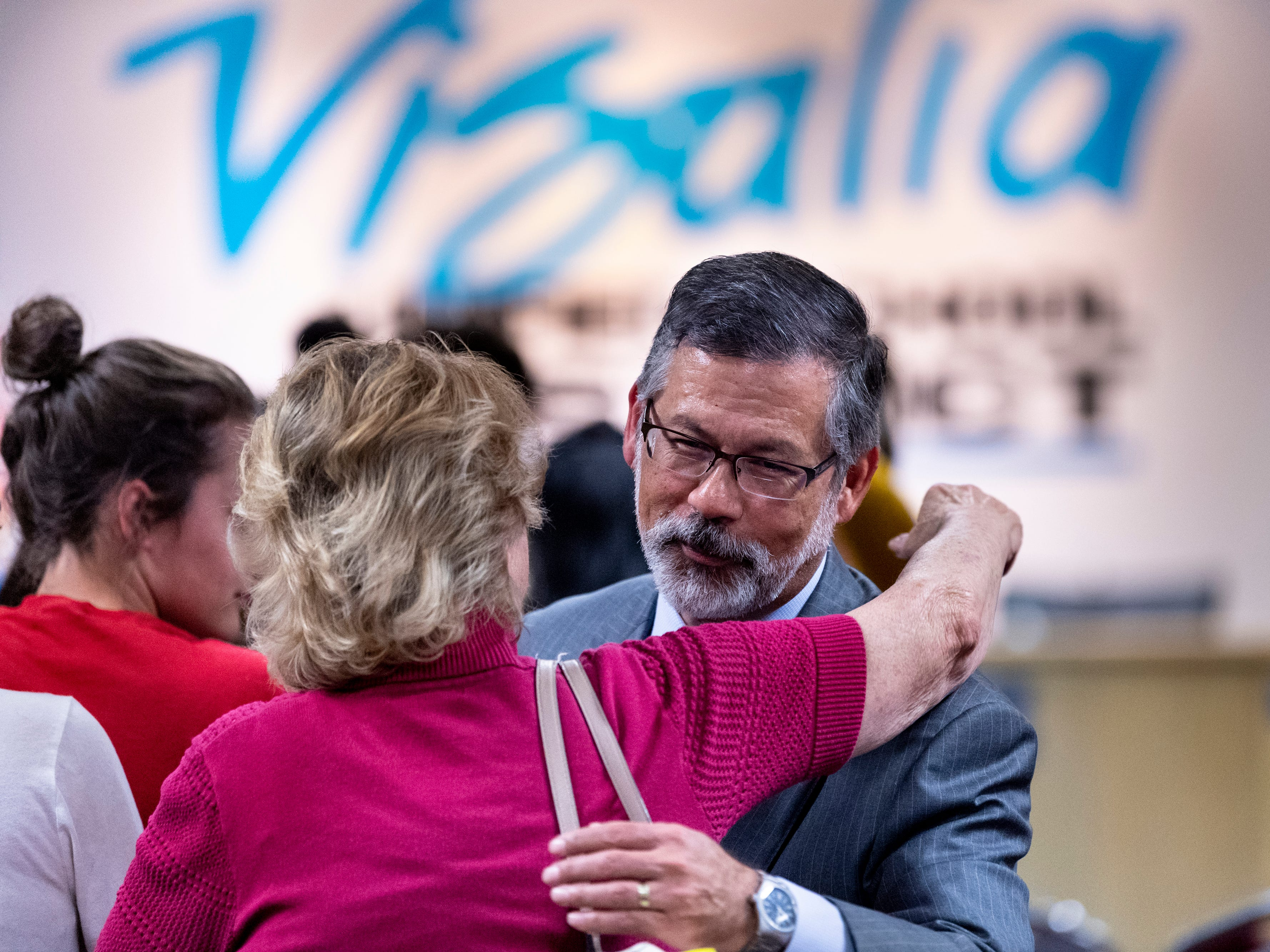 Dozens lined up to offer their support to Superintendent Todd Oto, right, after the Visalia Unified School board announced they had voted to accept his resignation on Tuesday, May 7, 2019.