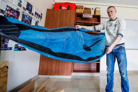 Student Noah Streveler poses for a photo Wednesday, April 24, 2019, with the hammock he made at Wausau Engineering and Global Leadership Academy charter high school in Wausau, Wis.