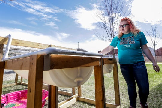 Student Bailey Bootz explains how her quaquaponics project works Wednesday, April 24, 2019, at Wausau Engineering and Global Leadership Academy charter high school in Wausau, Wis.