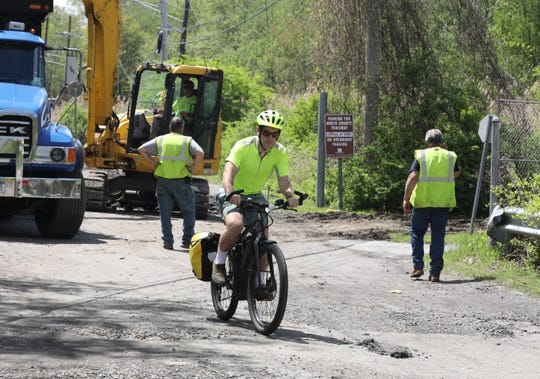 In this file photo, Dan Williams, a cyclist from Tarrytown, bikes to his job in Yorktown Heights and uses the north county trailway. Here he is pictured near the site in Millwood, as excavators work to repair and rebuild the popular site for cyclists, joggers and walkers, May 8, 2019.