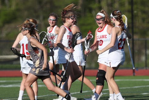 Fox Lane's Olivia Dey (10) celebrates a second half goal against fClarkstown South during girls lacrosse action at Fox Lane High School in Bedford May 8, 2019. Day finished with six goals and Fox Lane won the game 15-5.