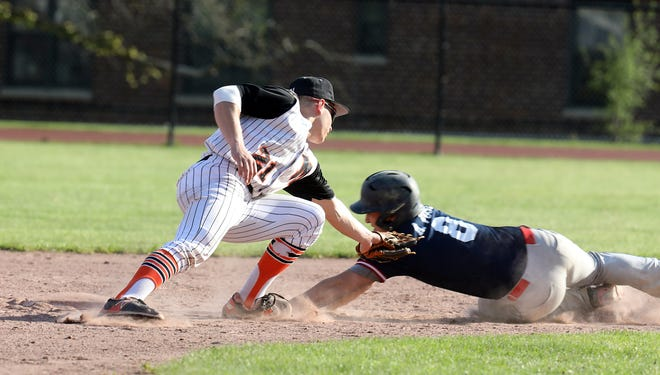 Mamaroneck's Michael Campbell (21) tags Ketcham's Anthony Vose (8) out at second during baseball game at Mamaroneck High School May 7, 2019. Mamaroneck wins 2-1 over Ketcham in the 8th inning.