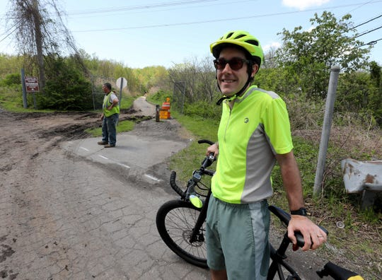 Dan Williams, a cyclist from Tarrytown, bikes to his job in Yorktown Heights and uses the north county trailway. Here he is pictured near the site in Millwood, as excavators work to repair and rebuild the popular site for cyclists, joggers and walkers, May 8, 2019.