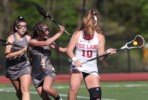 Fox Lane's Olivia Dey (10) may have her hair blocking her face,  but that didn't stop her from scoring  six goals against  Clarkstown South in girls lacrosse action at Fox Lane High School in Bedford May 8, 2019. Fox Lane won the game 15-5.