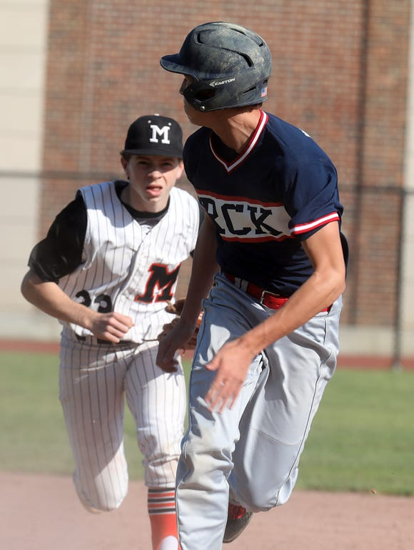 Ketcham's Xavier Kolhosser (20) outruns the tag from  Mamaroneck's Ryan Mc Intyre (23) during baseball game at Mamaroneck High School May 7, 2019. Mamaroneck wins 2-1 over Ketcham in the 8th inning.