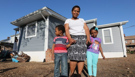 Ingrid Boucicaut, with her three year old twins, Ishmael and Isabella at their new Habitat for Humanity of Rockland house on Westside Ave. in Haverstraw May 8, 2019.