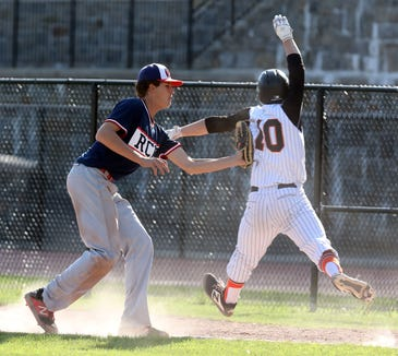 Ketcham's Xavier Kolhosser (20) tags Mamaroneck's Zach Kringdon (10) out at first during baseball game at Mamaroneck High School May 7, 2019. Mamaroneck wins 2-1 over Ketcham in the 8th inning.