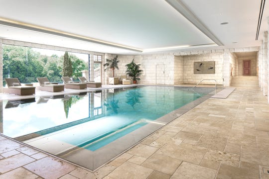 The current owners undertook a massive renovation that includes this amazing indoor pool with doors that open fully to the outdoors.