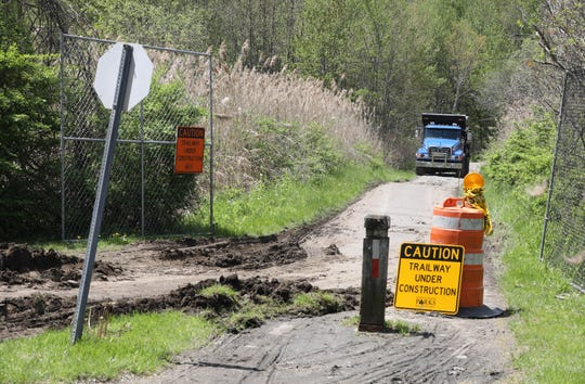 Excavators work at the site of the north county trailway in Millwood as they repair and rebuild the popular site for cyclists, joggers and walkers, May 8, 2019.
