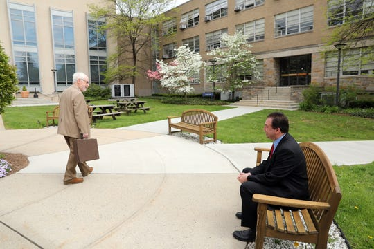 Jeffrey Deskovic, 45, right, chats with a professor before the final test for his law degree at Pace University Elisabeth Haub School of Law in White Plains May 8, 2019. Deskovic was wrongfully convicted of rape/murder of his Peekskill High School classmate. He spent 16 years in prison before he finally got permission to re-run DNA and it matched a convicted killer.