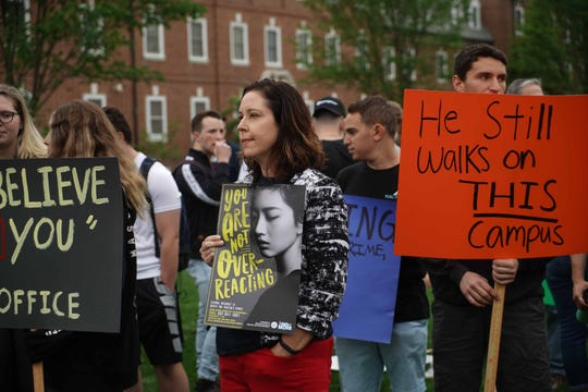 Chrysanthi Leon, an associate professor of sociology at the University of Delaware, came out to support Alyvia Pauzer, 19, a sophomore, during a silent protest on the university's Green Wednesday afternoon  to bring attention to state prosecutors decision not to file charges in Pauzer's rape case.