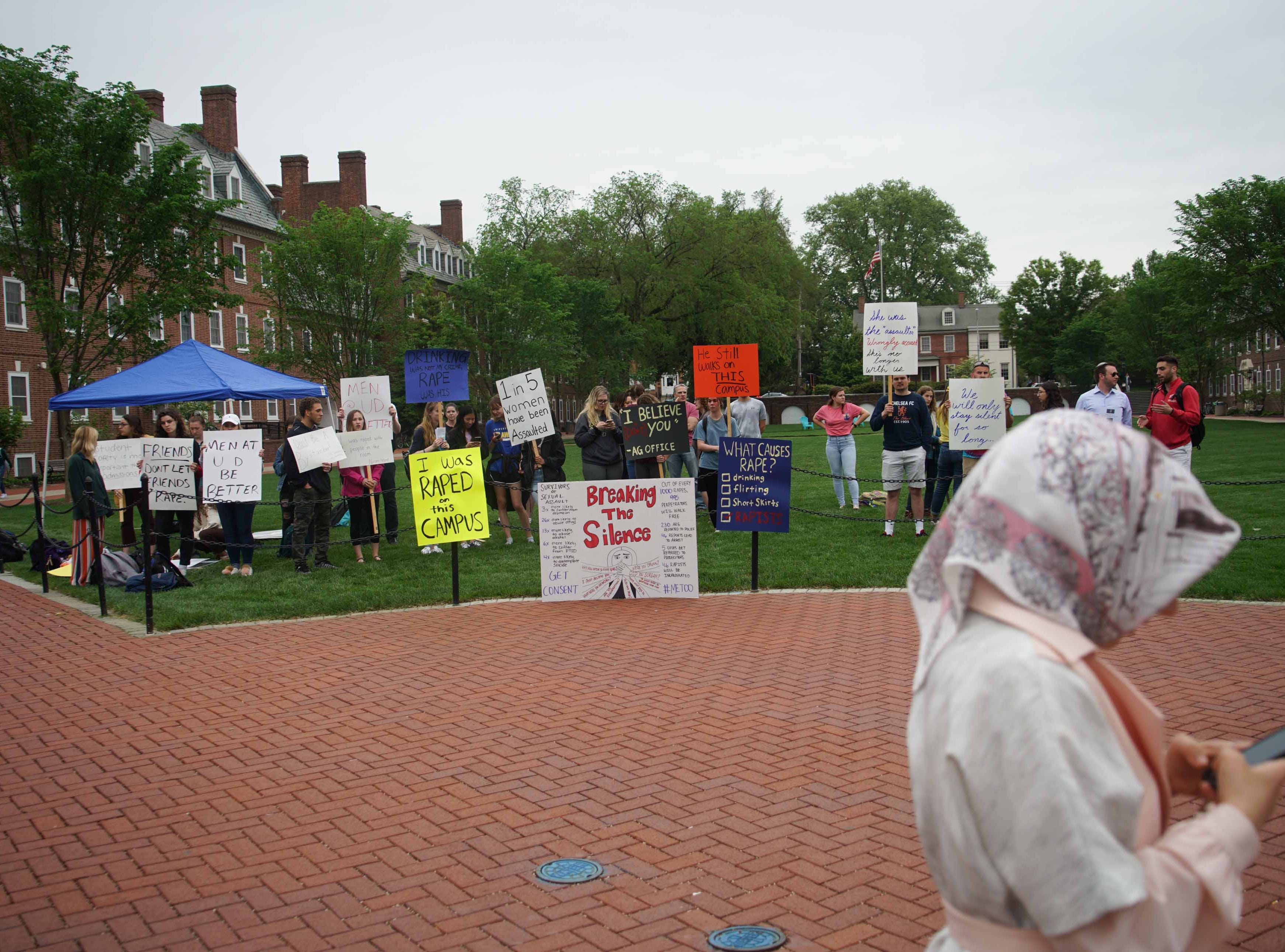 Alyvia Pauzer, 19, a sophomore at the University of Delaware, gathers with fellow students and some faculty on the university's Green Wednesday afternoon for a silent protest to bring attention to state prosecutors decision not to file charges in her rape case.