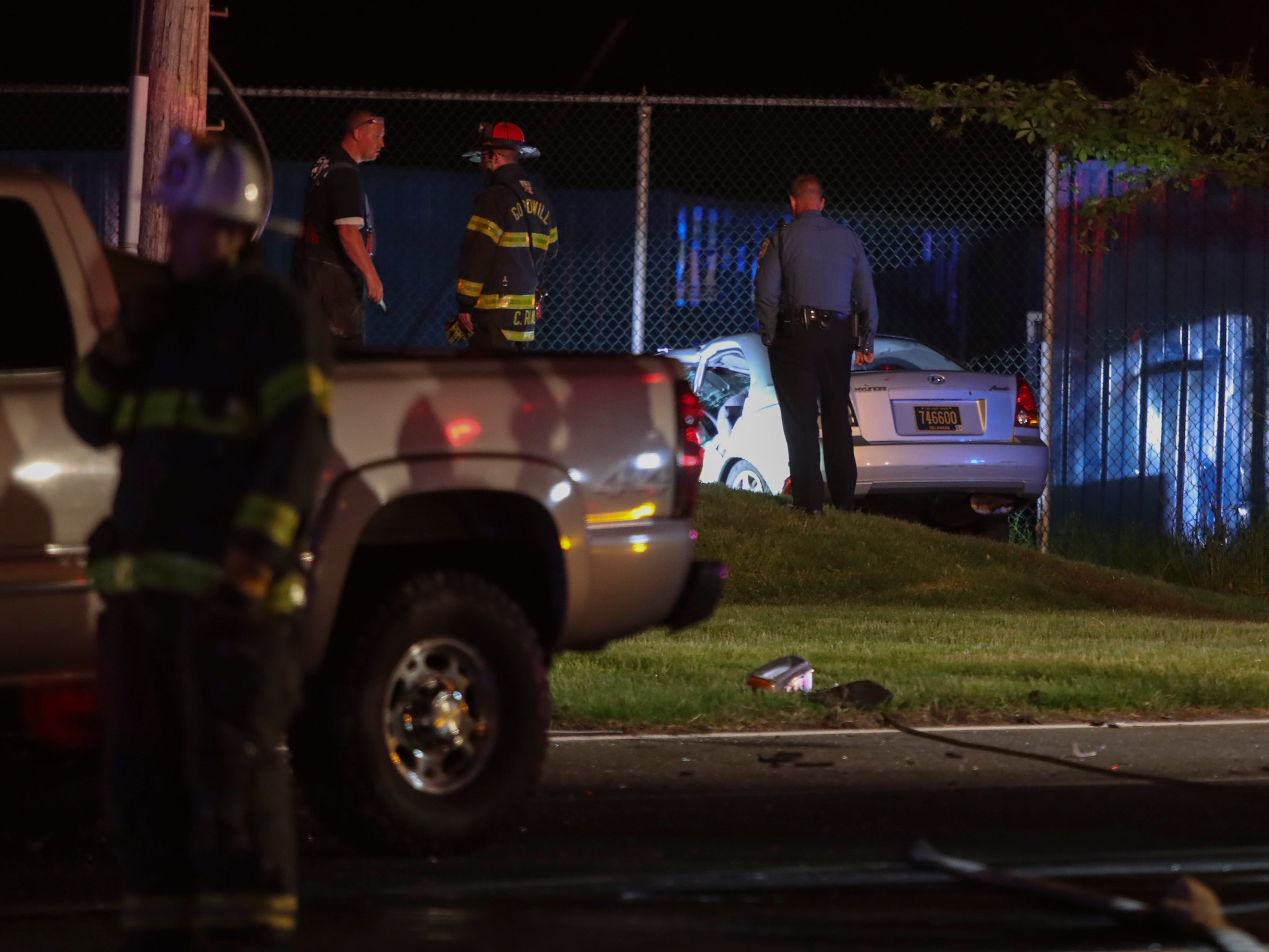 Emergency personnel work at the scene of a fatal two-car accident on River Road at Grantham Lane, reported at 9:11 p.m. Tuesday.