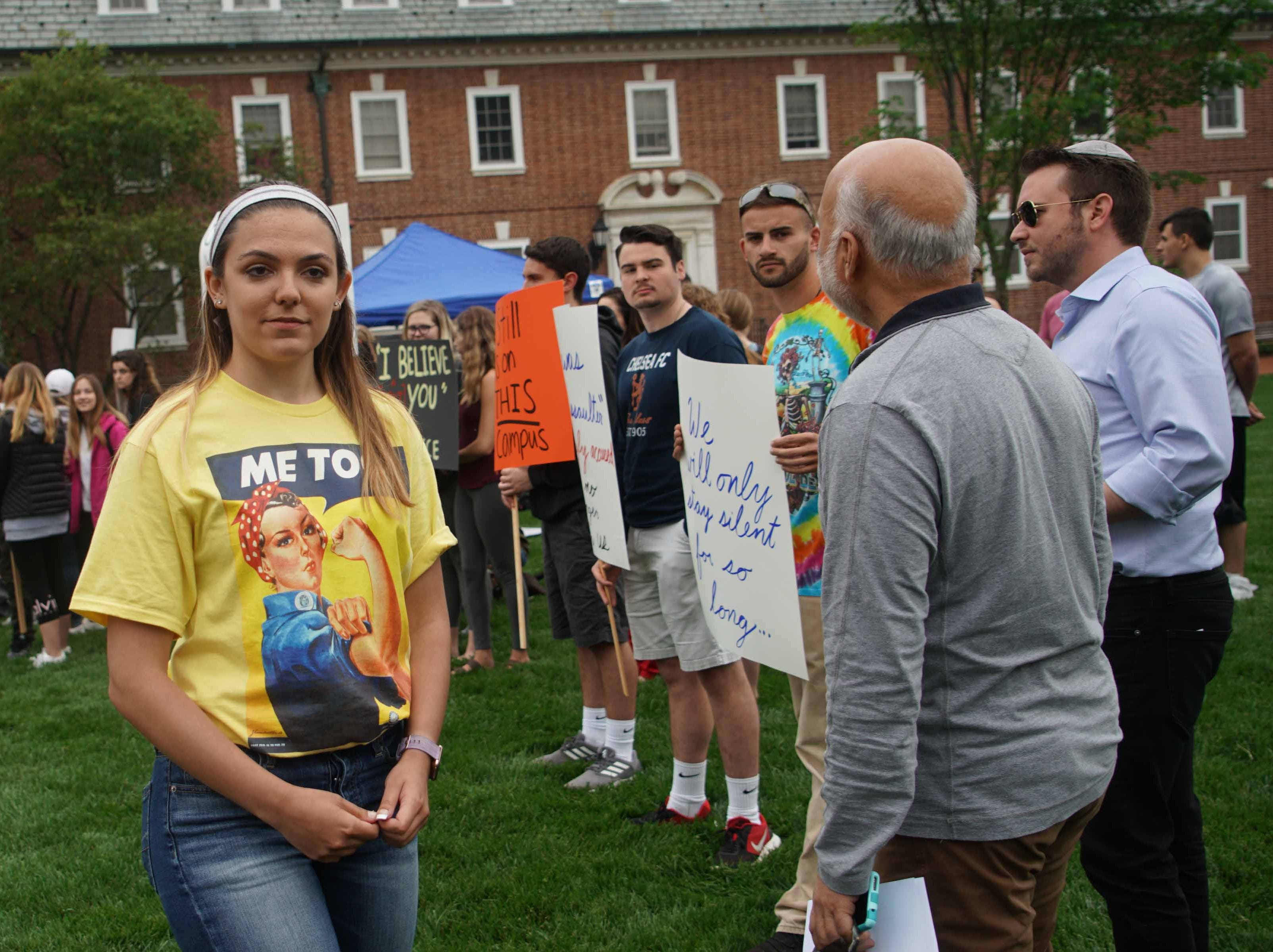 Alyvia Pauzer, 19, a sophomore at the University of Delaware, gathers with fellow students and some faculty on the university's Green Wednesday afternoon for a silent protest to bring attention to state prosecutors decision not to file charges in her sexual assault case.