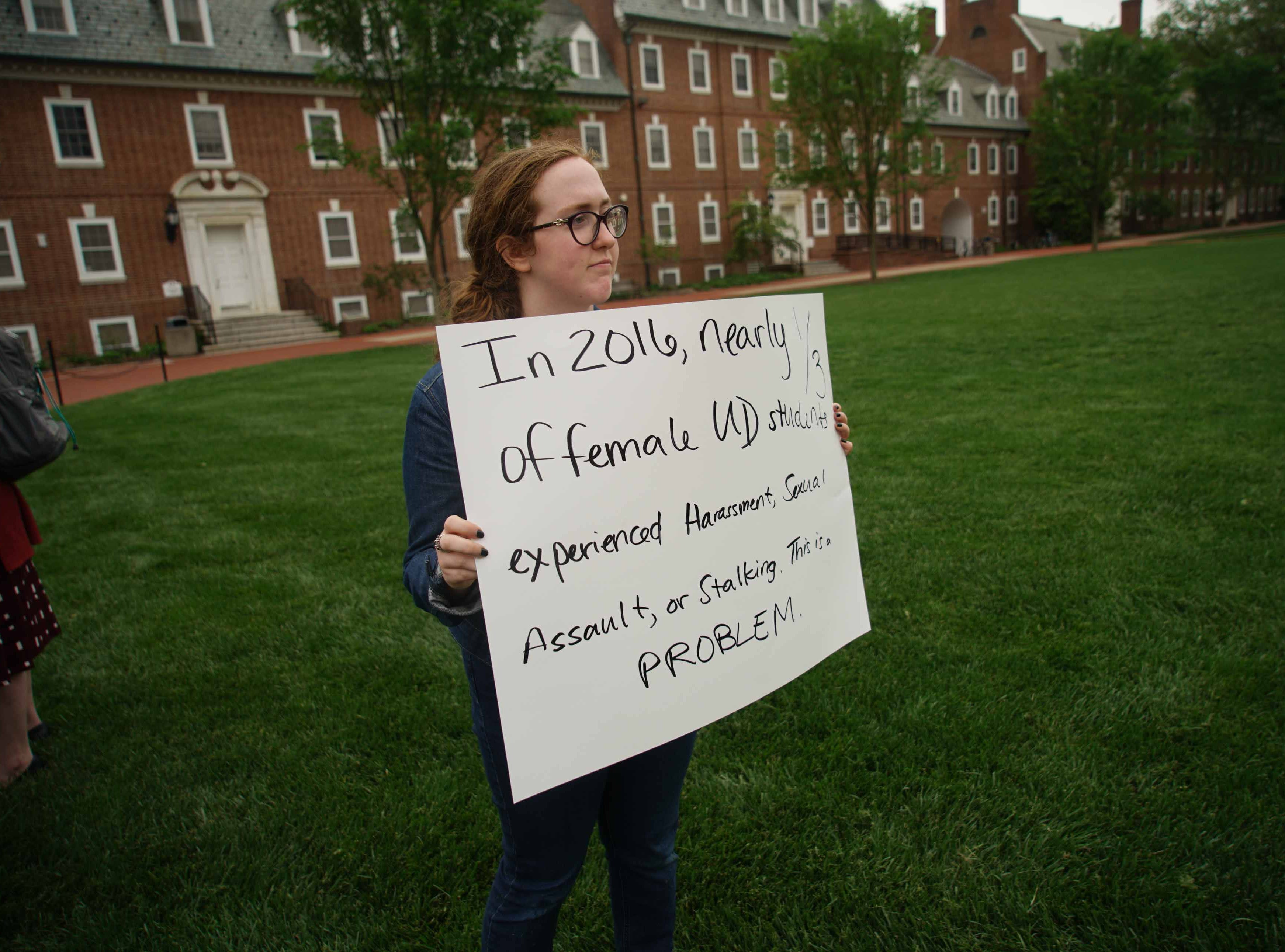 Kylie Boggs, 19, a friend of Alyvia Pauzer, both sophomores at the University of Delaware, gather with fellow students and some faculty on the university's Green Wednesday afternoon for a silent protest to bring attention to state prosecutors decision not to file charges Pauzer's sexual assault case.