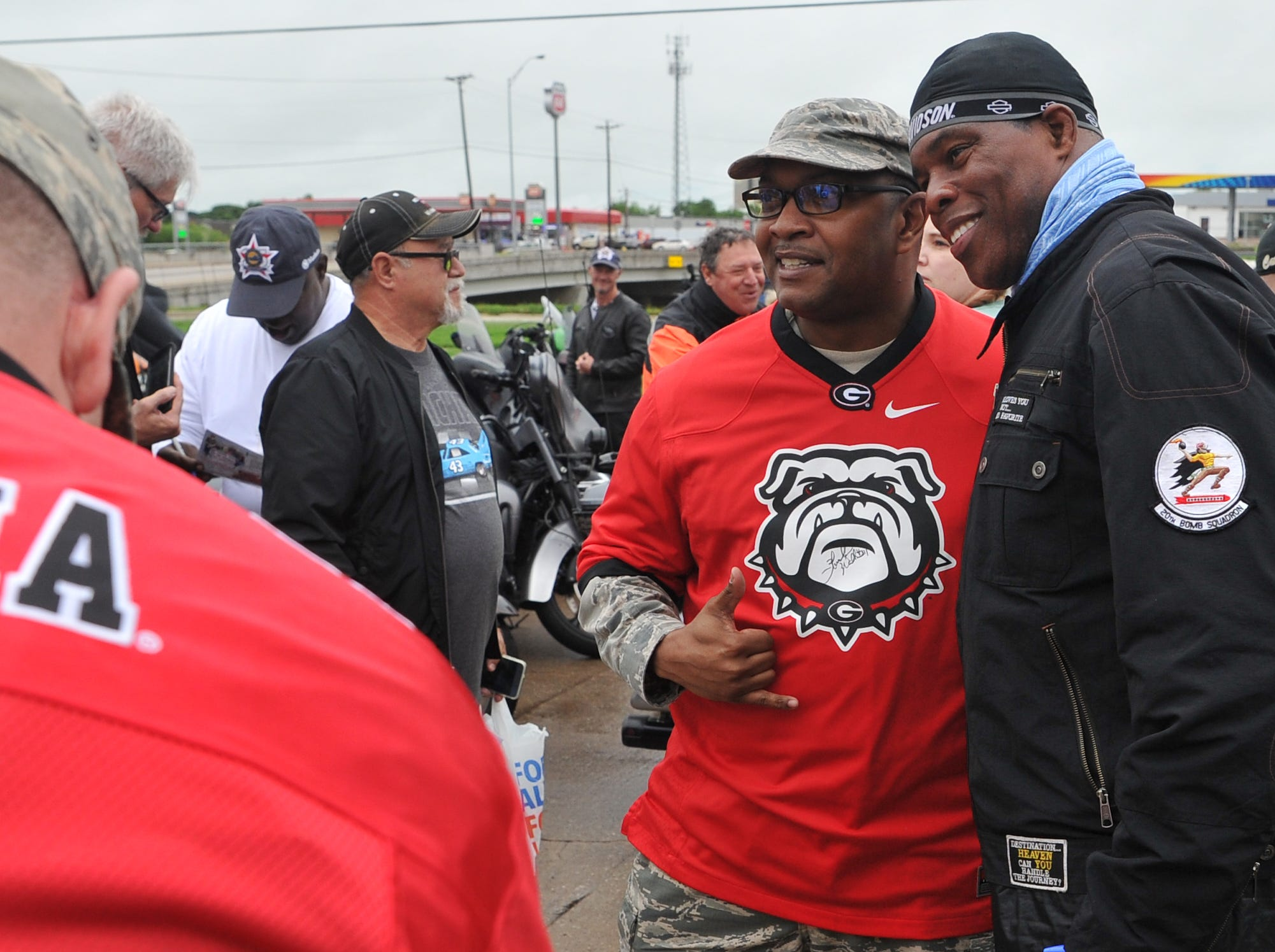 Former American football player Herschel Walker signed autographs and posed for pictures, Wednesday morning during the Kyle Petty Charity Ride's fuel stop at the Loves Truck Stop.