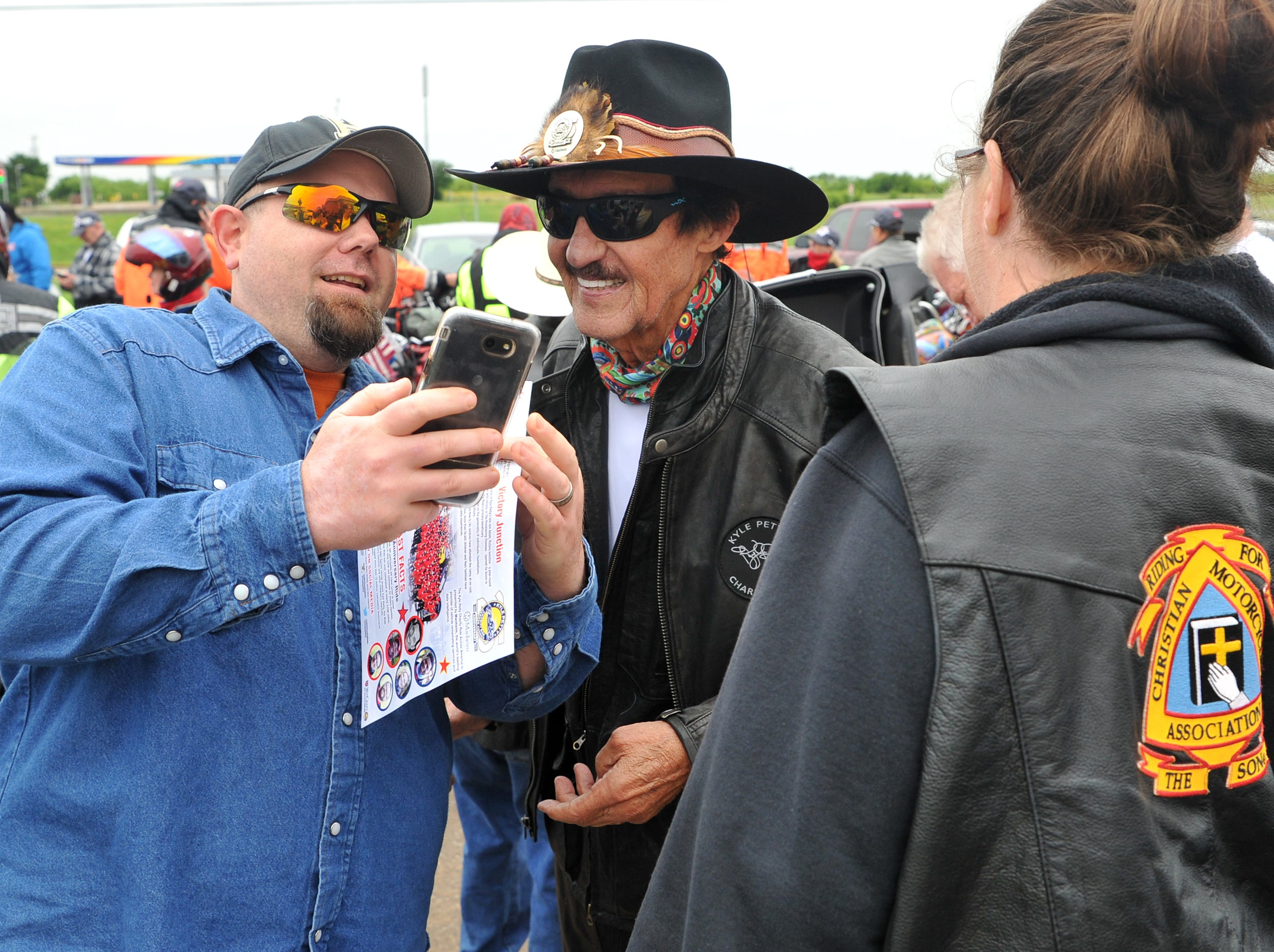 Former NASCAR driver Richard Petty met with fans, Wednesday morning while his son's, Kyle Petty, charitable motorcycle ride made a fuel stop in Wichita Falls.
