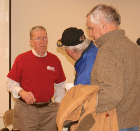 Quantum Dairy founder, Richard Wagner (left), answers questions from farm tour attendees.