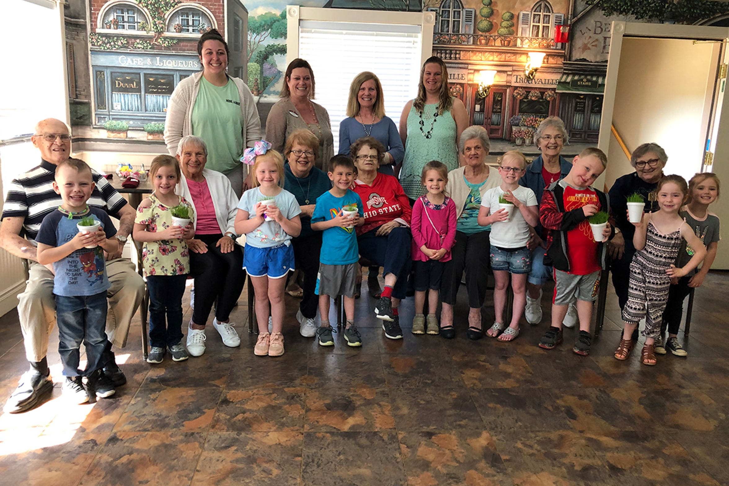 The smiles on the faces of the grandfriends and the children illustrate firsthand the impact that Timeless Wings has on their lives. The partnership between The Little Barnyard and Primrose Retirement Community is the fourth such program of Colleen Romito's vision. Those helping with the session on this day were, back row from left Abbie Keister, from The Little Barnyard, Cindy Clark, of Primrose, Colleen Romito and Kalynn Moorehead, of Primrose.