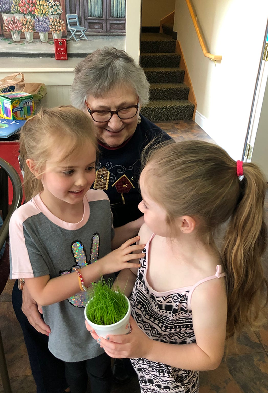 Primrose resident, Dolores, talks with Little Barnyard students, Adrianna, l, and Braylee, r, during the newest intergenerational program that Colleen Romito of Timeless Wings has coordinated in Zanesville.
