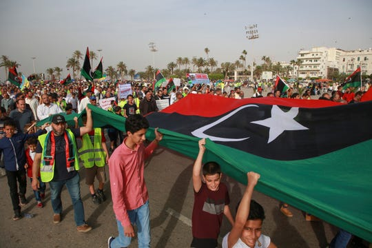 Libyans hold a demonstration at Martyrs' Square against military operations by forces loyal to Field Marshal Khalifa Hifter in Tripoli, Libya, Friday, May 3, 2019.