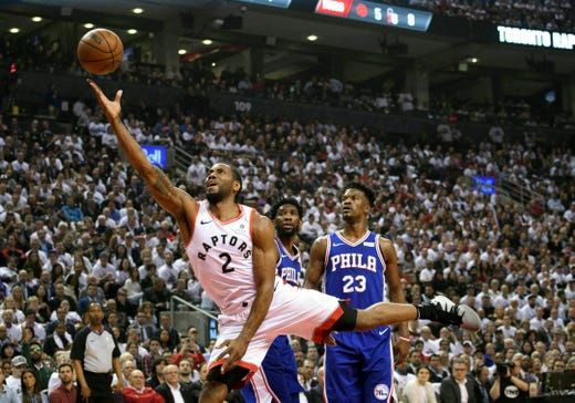 May 7: Raptors forward Kawhi Leonard drives to the basket as 76ers stars  Jimmy Butler (23) and Jimmy Butler look on during Game 5. Toronto routed Philadelphia 125-89 to take a 3-2 series lead.