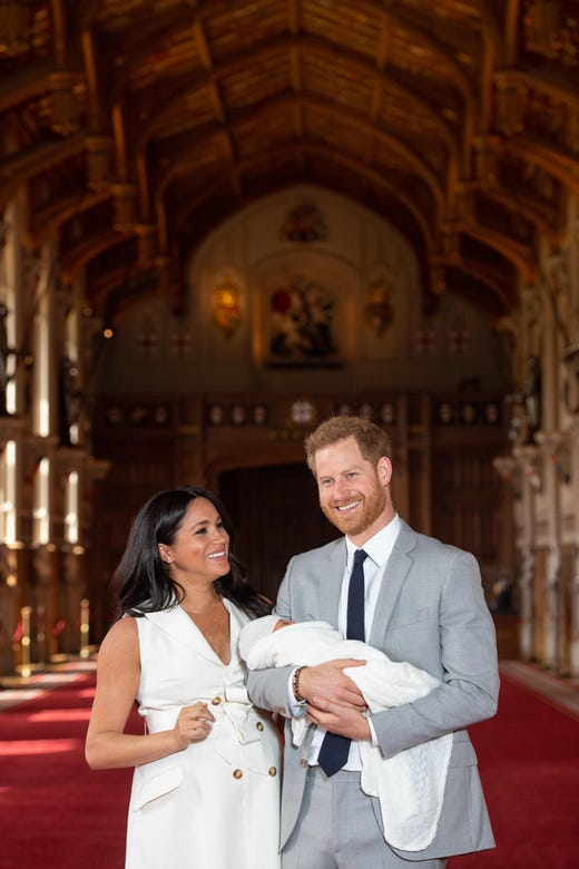 Britain's Prince Harry, Duke of Sussex (R), and his wife Meghan, Duchess of Sussex, pose for a photo with their newborn baby son in St George's Hall at Windsor Castle in Windsor, west of London on May 8, 2019. (Photo by Dominic Lipinski / POOL / AFP)DOMINIC LIPINSKI/AFP/Getty Images ORIG FILE ID: AFP_1GA0B8