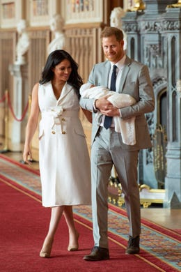 Britain's Prince Harry, Duke of Sussex (R), and his wife Meghan, Duchess of Sussex, pose for a photo with their newborn baby son in St George's Hall at Windsor Castle in Windsor, west of London on May 8, 2019. (Photo by Dominic Lipinski / POOL / AFP)DOMINIC LIPINSKI/AFP/Getty Images ORIG FILE ID: AFP_1GA08A