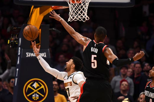 May 7: Denver Nuggets guard Jamal Murray shoots around Portland Trail Blazers guard Rodney Hood (5) in the second quarter of Game 5.