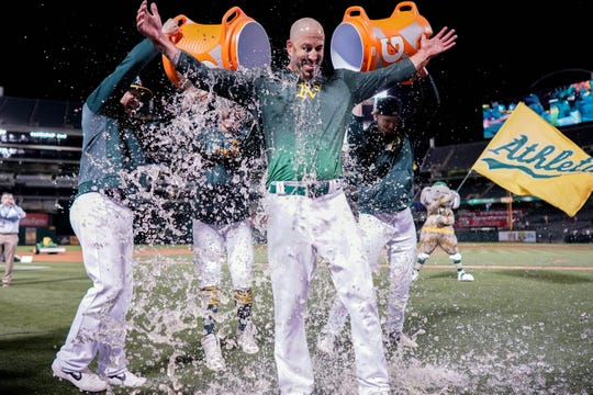 Oakland Athletics starting pitcher Mike Fiers (50) is doused after pitching a no-hitter against the Cincinnati Reds at Oakland Coliseum.
