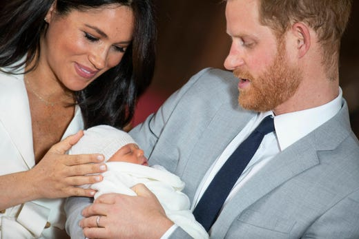 """Britain's Prince Harry and Meghan, Duchess of Sussex, during a photocall with their newborn son, in St George's Hall at Windsor Castle, Windsor, south England, Wednesday May 8, 2019. Baby Sussex was born Monday at 5:26 a.m. (0426 GMT; 12:26 a.m. EDT) at an as-yet-undisclosed location. An overjoyed Harry said he and Meghan are """"thinking"""" about names. (Dominic Lipinski/Pool via AP) ORG XMIT: LON140"""
