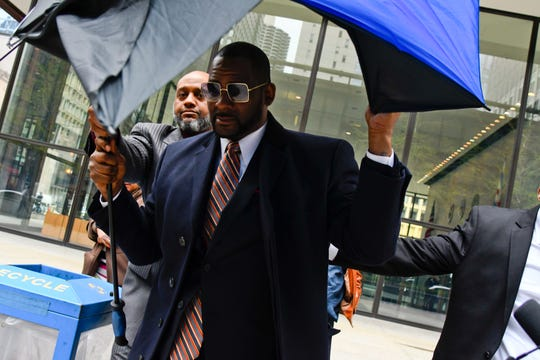 Musician R. Kelly leaves the Daley Center in Chicago on Wednesday after a hearing in his child support case.