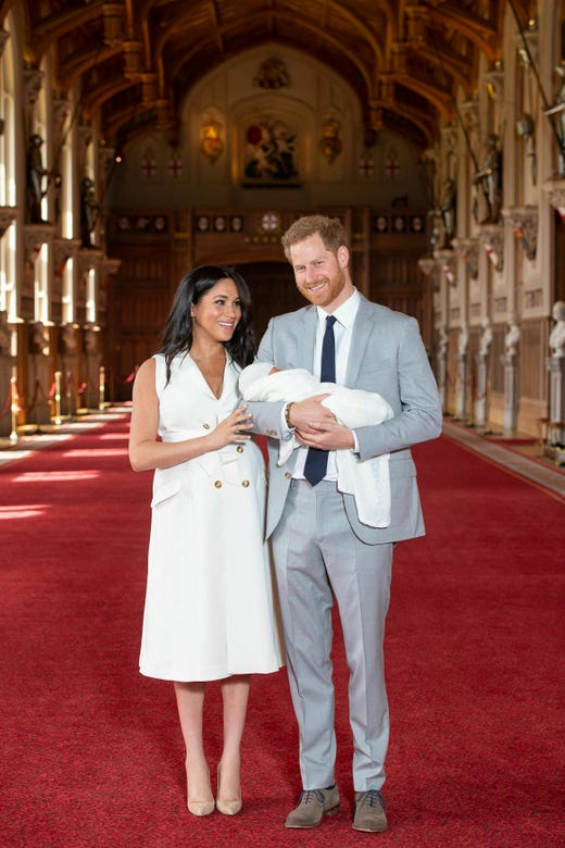 """Britain's Prince Harry and Meghan, Duchess of Sussex, during a photocall with their newborn son, in St George's Hall at Windsor Castle, Windsor, south England, Wednesday May 8, 2019. Baby Sussex was born Monday at 5:26 a.m. (0426 GMT; 12:26 a.m. EDT) at an as-yet-undisclosed location. An overjoyed Harry said he and Meghan are """"thinking"""" about names. (Dominic Lipinski/Pool via AP) ORG XMIT: LON109"""