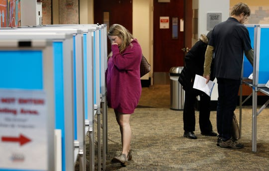 """A voter casts her ballot at the Denver Elections Division Tuesday, May 7, 2019, in Denver. Voters decided against making Denver the first U.S. city to decriminalize the use of psilocybin, the psychoactive substance in """"magic mushrooms."""""""