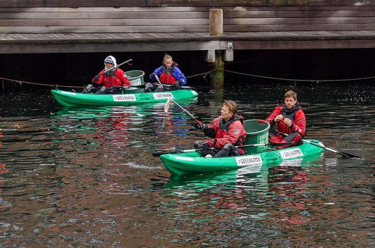 Volunteers kayaking with GreenKayak, a Denmark-based nonprofit that allows people to kayak for free if they pick up trash.