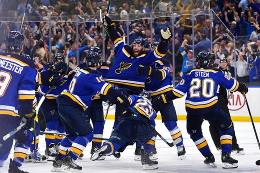 Second round: Patrick Maroon, a St. Louis native, is mobbed by his teammates after he lifted the Blues to a double-overtime victory in Game 7 of their series against the Dallas Stars.