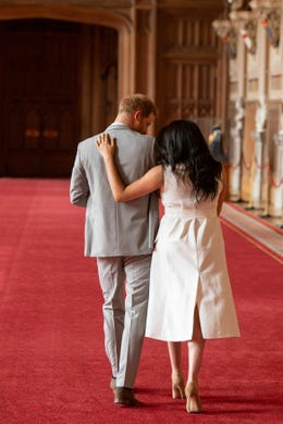 """Britain's Prince Harry and Meghan, Duchess of Sussex, leaves after a photocall with their newborn son, in St George's Hall at Windsor Castle, Windsor, south England, Wednesday May 8, 2019. Baby Sussex was born Monday at 5:26 a.m. (0426 GMT; 12:26 a.m. EDT) at an as-yet-undisclosed location. An overjoyed Harry said he and Meghan are """"thinking"""" about names. (Dominic Lipinski/Pool via AP) ORG XMIT: LON141"""