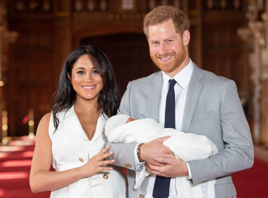 Britain's Prince Harry, Duke of Sussex (R), and his wife Meghan, Duchess of Sussex, pose for a photo with their newborn baby son in St George's Hall at Windsor Castle in Windsor, west of London on May 8, 2019. (Photo by Dominic Lipinski / POOL / AFP)DOMINIC LIPINSKI/AFP/Getty Images ORIG FILE ID: AFP_1GA04T