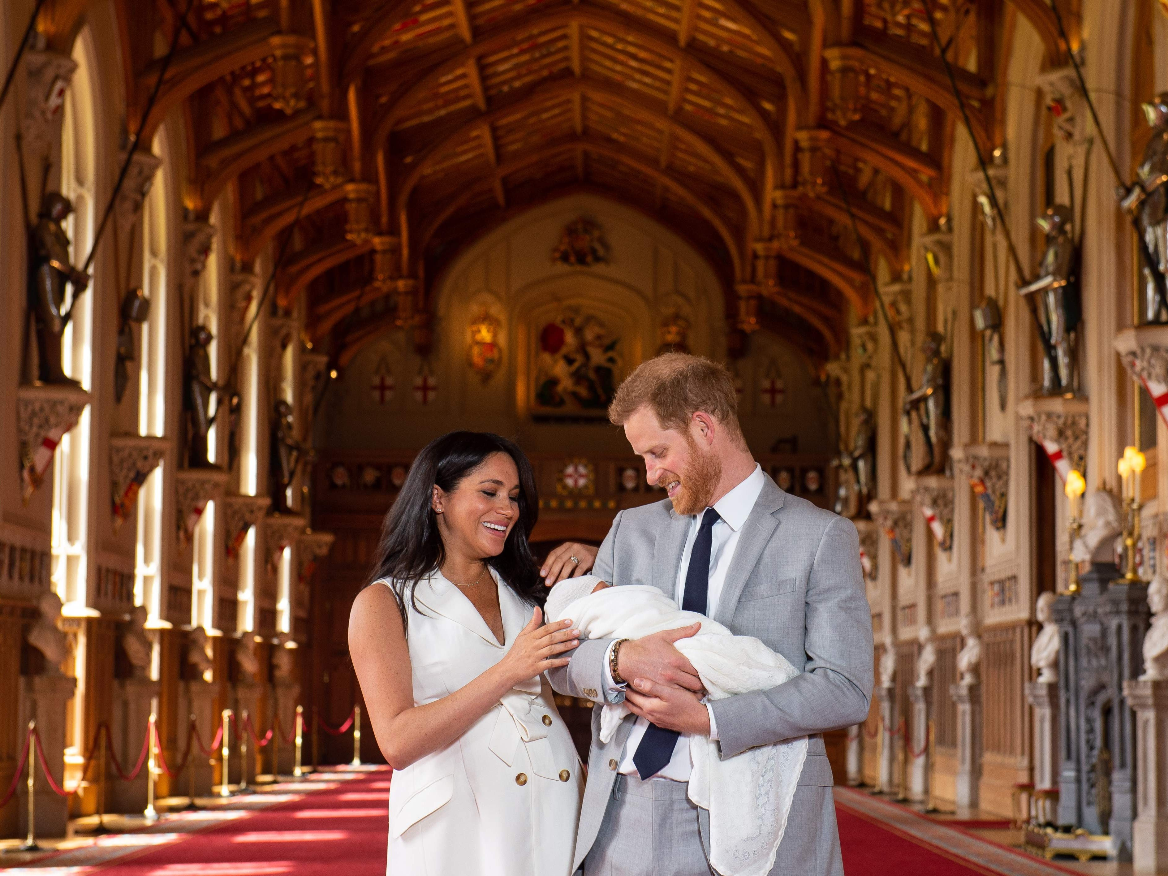 Britain's Prince Harry, Duke of Sussex (R), and his wife Meghan, Duchess of Sussex, pose for a photo with their newborn baby son in St George's Hall at Windsor Castle in Windsor, west of London on May 8, 2019. (Photo by Dominic Lipinski / POOL / AFP)DOMINIC LIPINSKI/AFP/Getty Images ORIG FILE ID: AFP_1GA01E