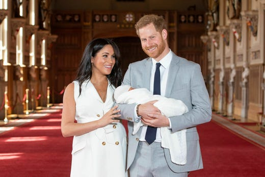 """Britain's Prince Harry and Meghan, Duchess of Sussex, during a photocall with their newborn son, in St George's Hall at Windsor Castle, Windsor, south England, Wednesday May 8, 2019. Baby Sussex was born Monday at 5:26 a.m. (0426 GMT; 12:26 a.m. EDT) at an as-yet-undisclosed location. An overjoyed Harry said he and Meghan are """"thinking"""" about names. (Dominic Lipinski/Pool via AP) ORG XMIT: LON111"""