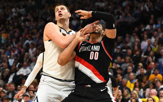 May 7: Denver Nuggets center Nikola Jokic (15) and Portland Trail Blazers center Enes Kanter (00) battle for position in the second quarter in Game 5.