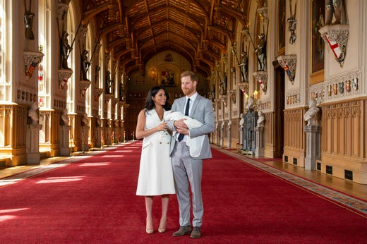 """Britain's Prince Harry and Meghan, Duchess of Sussex, during a photocall with their newborn son, in St George's Hall at Windsor Castle, Windsor, south England, Wednesday May 8, 2019. Baby Sussex was born Monday at 5:26 a.m. (0426 GMT; 12:26 a.m. EDT) at an as-yet-undisclosed location. An overjoyed Harry said he and Meghan are """"thinking"""" about names. (Dominic Lipinski/Pool via AP) ORG XMIT: LON113"""