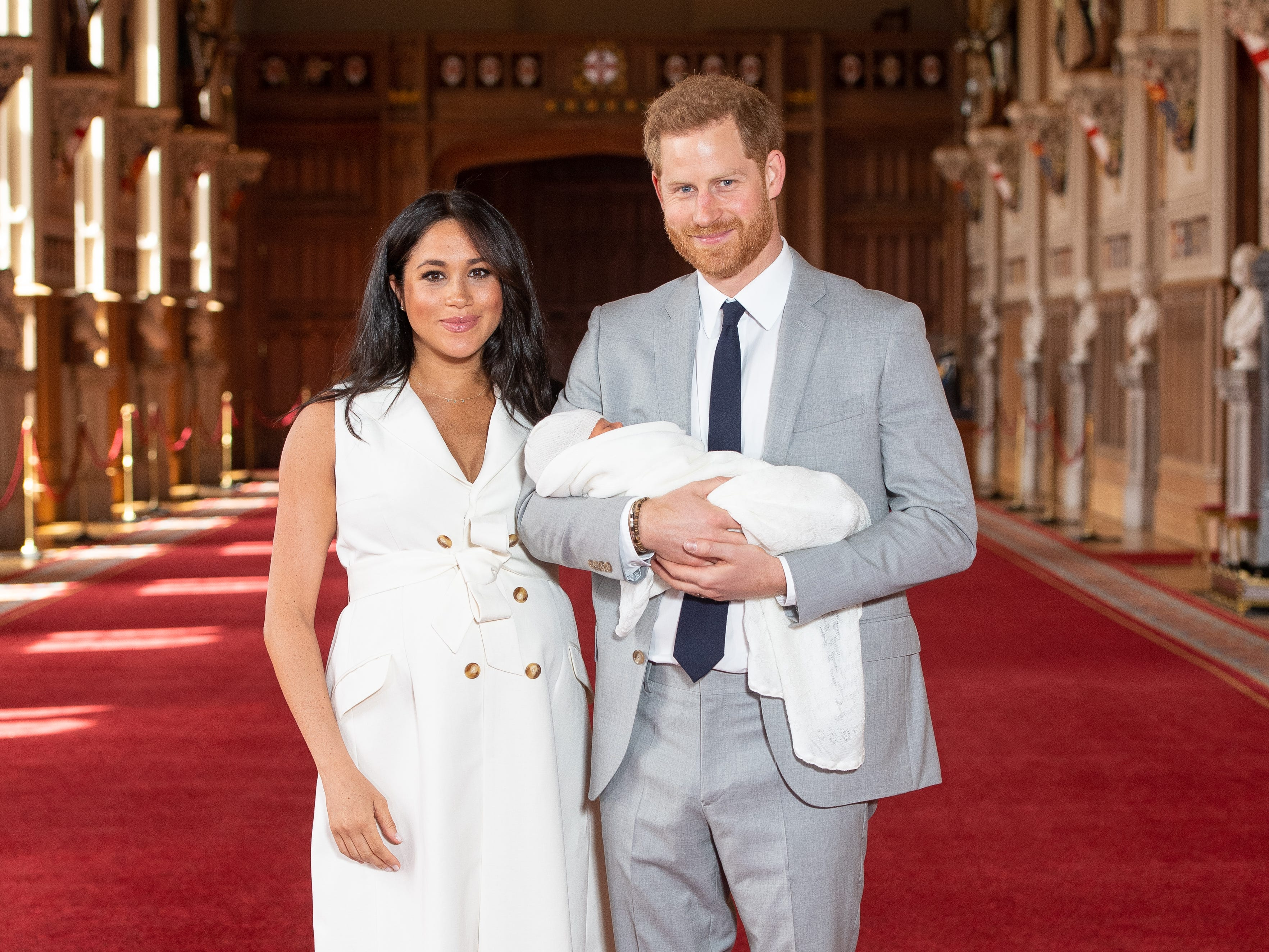 Prince Harry and Duchess Meghan of Sussex pose with their newborn son in St George's Hall at Windsor Castle on May 8, 2019.