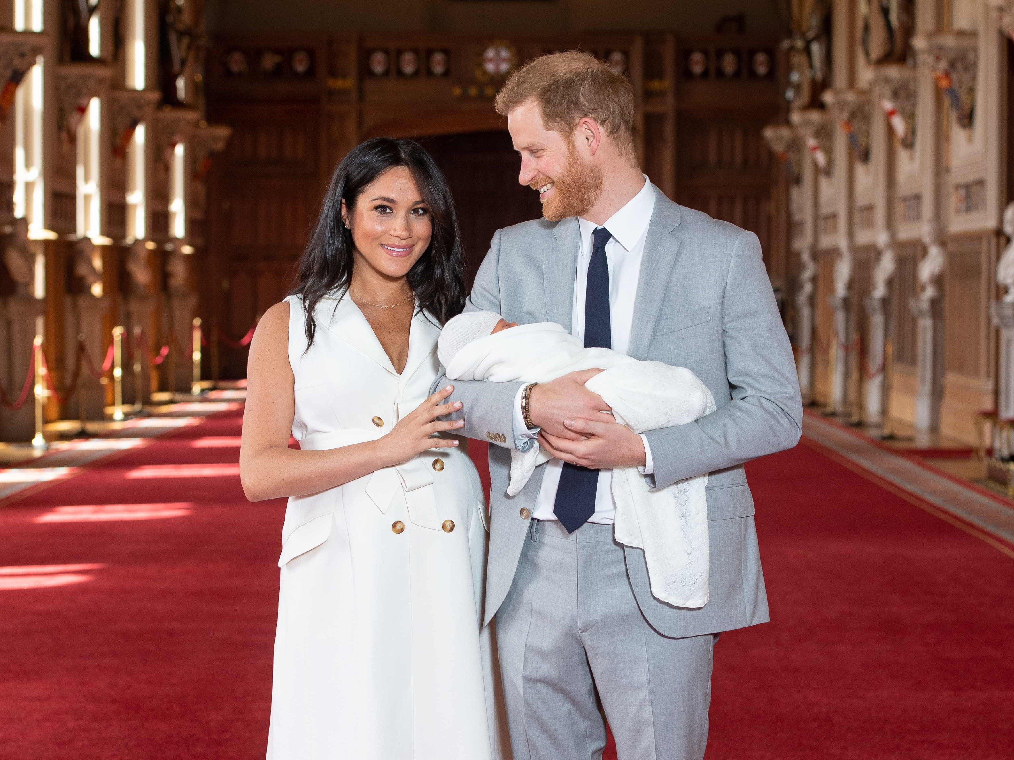 Britain's Prince Harry, Duke of Sussex (R), and his wife Meghan, Duchess of Sussex, pose for a photo with their newborn baby son in St George's Hall at Windsor Castle in Windsor, west of London on May 8, 2019. (Photo by Dominic Lipinski / POOL / AFP)DOMINIC LIPINSKI/AFP/Getty Images ORIG FILE ID: AFP_1GA01F