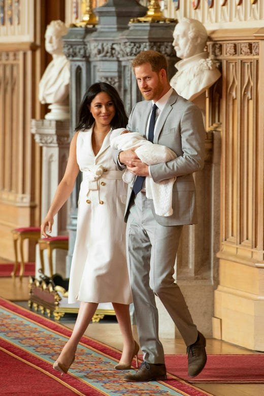 """Britain's Prince Harry and Meghan, Duchess of Sussex, arrive for a photocall with their newborn son, in St George's Hall at Windsor Castle, Windsor, south England, Wednesday May 8, 2019. Baby Sussex was born Monday at 5:26 a.m. (0426 GMT; 12:26 a.m. EDT) at an as-yet-undisclosed location. An overjoyed Harry said he and Meghan are """"thinking"""" about names. (Dominic Lipinski/Pool via AP) ORG XMIT: LON112"""