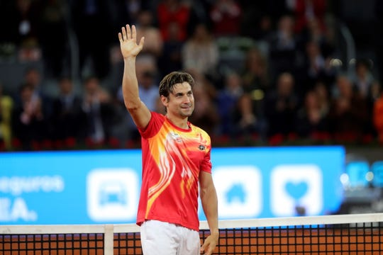 David Ferrer waves to supporters during a tribute after his match at the Mutua Madrid Open.